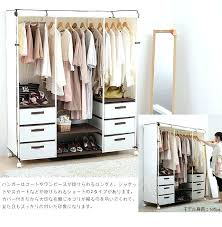 enclosed clothes rack covered garment rack on wheels covered garment rack covered clothes rack drawers curtains enclosed clothes rack