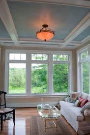 sunroom with ceiling fan and floor to ceiling windows I would like
