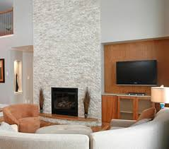 contemporary living room with white stacked stone fireplace