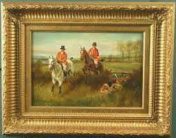 a pair of paintings of fox hunting with hounds oil on panel signed sanderson wells was known for his paintings of animals and sporting events