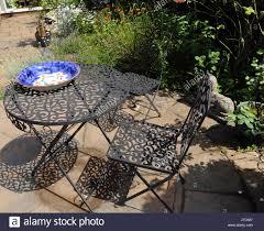 wrought iron garden furniture and shadows in summer birmingham west midlands england