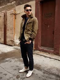 men s tan barn jacket navy v neck sweater blue crew neck t shirt navy jeans men s fashion