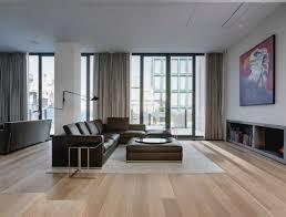 Wood floors in living room Yellow Carpet One Light Hardwood Floors Dark Furniture
