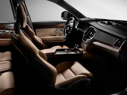 the first edition of the all new volvo xc90 has an interior featuring nappa leather seats in amber a charcoal leather dashboard and linear walnut inlays