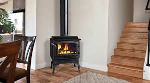 regency c34 small gas freestanding stove shown with black cast iron legs and black door