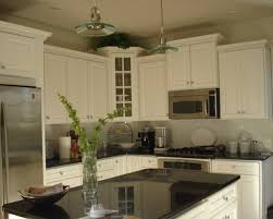 over stove lighting. elegant kitchen photo in new york over stove lighting