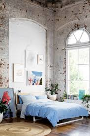 Exposed brick is practically synonymous with urban loft spaces, giving many  a loft bedroom and