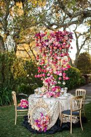gorgeous chandelier with flowers for an outside wedding love the cascading roses