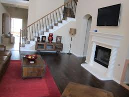 Dark Shaw Laminate Flooring With Red Rugs And Storage Coffee Table Plus  Fireplace Mantle