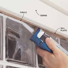 seal the gap between the glass block window panel and sill plate both inside and out with silicone or acrylic latex caulk