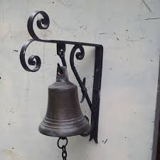 old doorbell in bronze with wall mount and bell puller in wrought iron