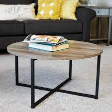 low round coffee table with distressed gray brown woodgrain finish and black metal legs