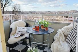 For a small balcony, small little chairs and table are a perfect addition!