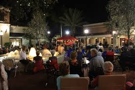 visitors to midtown in palm beach gardens enjoy a live performance as part of mainstreet