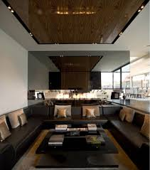 Modern Living Room With Brown Leather Sofa Black Leather Ottoman Coffee Table With Brown Wooden Tray