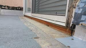 without metal door pan water penetrates seam where floor meets door
