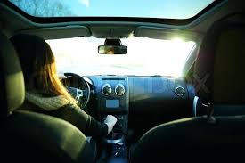 back seat of car stock image of young woman driving a car view from backseat car