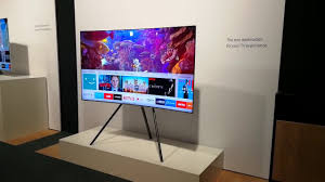 samsung tv on stand. samsung qled tv global launch on a studio stand tv e