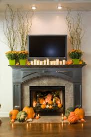 39 amazing fall mantel d cor ideas fall mantel d cor with white wall black fireplace orange pumpkin fall flower ornament led tv hardwood floor and rug
