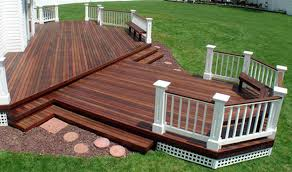 outdoor deck paint or stain. another deep dark brown stained deck is completed in lenexa kansas with white wood trim outdoor paint or stain s