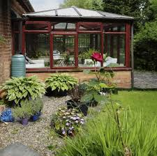 garden greenhouse. here is an attached greenhouse with a foundation and glass for its glazing. this garden o