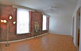original hardwood flooring and exposed brick