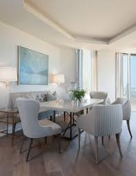 vanguard s table and host chairs center this dining area with additional seating that offers a tasteful
