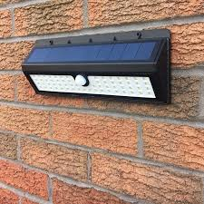 solar power pir motion sensor 62 led security wall light
