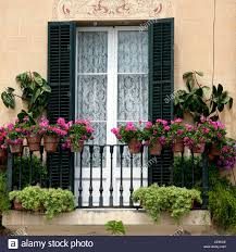 Decorative Window Boxes Decorative window with shutters and window boxes in Sitges Spain 18