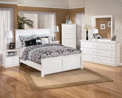 furniture white wooden bed with black bedding set and white wooden dressing table on the