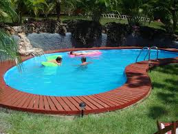 Swimming Pool:Enjoyable Backyard Landscaping Design Ideas Complete Stone  Surround Swimming Pool Plus Chrome Handrail