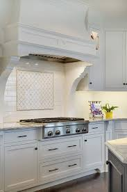 Inspiring Lake House Interiors  Stove BacksplashWhite Subway ...