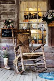 americana photograph old wooden rocking chair on a wooden porch by jeremy woodhouse