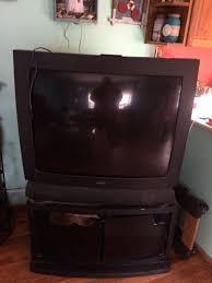 crt tv stuck in standby mode used black with brown wooden stand for