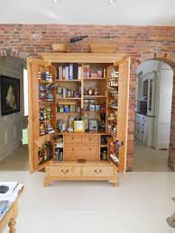 Alluring Brown Finish Freestanding Kitchen Pantry Cabinet Two Small Drawer  Underneath Kitchen Pantry Shelves Built In Pantry Ideas Storage Shelves Are  Built ...