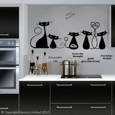 black cool cats wall decal above a kitchen hob and worksurface