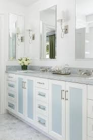 white and blue washstand cabinet doors