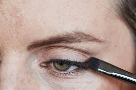 draw a thin line with eyeliner at the lash line following your eye shape from the inner to the outer corner of your lid with a bit of eyeshadow powder on