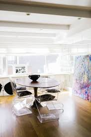 pedestal table and lucite chairs