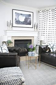 blue black and white fireplace sitting area with leather swivel chairs