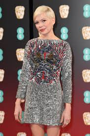 michelle williams we just have one question about your louis michelle williams we just have one question about your louis vuitton at the ee bafta awards