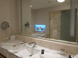 TV fitted in the bathroom mirror Picture of Four Seasons Hotel