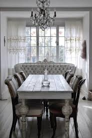 this gorgeous farmhouse dining room has both shabby chic glamorous touches love the vine table fabulous crystal chandelier