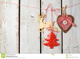 Rustic Christmas Ornaments Rustic Christmas Decorations Hanging Over Wooden Background With