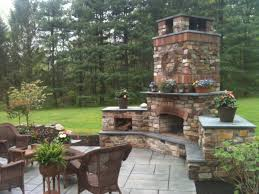 Traditional Patio Design with Patio Stone Fireplace Kit and Wood