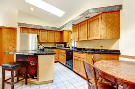Kitchen With Vaulted Ceilings Hight Vaulted Ceiling Kitchen With Light Brown Storage Cabinets