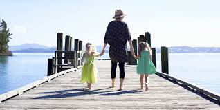 life as a single mom essay what you don t know until you re a  mom hold hands two small daughters on a pier