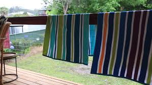 Image Hooks Colourful Of Beach Towel Hanging On The Wood Bench At The Back Yard Shutterstock Colourful Of Beach Towel Hanging Stock Footage Video 100