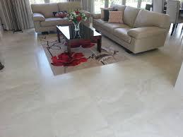 living room tiles. travertino bone porcelain tiles - 45 capriana dr, karaka traditional-living- room living
