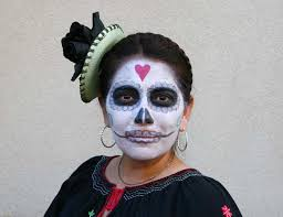 skull face paint and costume for day of the dead in oakland